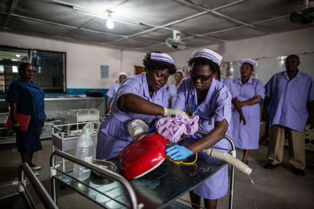 Students at the Masuba Midwifery School practice cardiopulmonary resuscitation on a dummy during a demonstration...