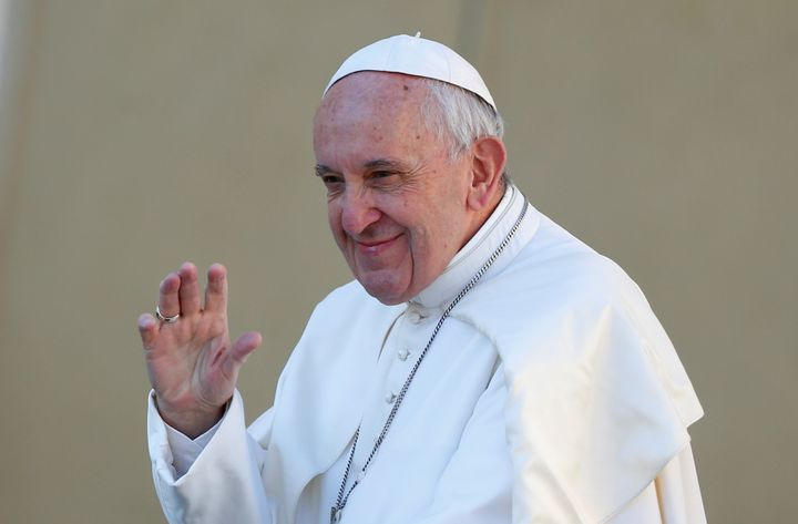 Pope Francis waves as he arrives to lead his Wednesday general audience in Saint Peter's square at the Vatican, March 29, 201