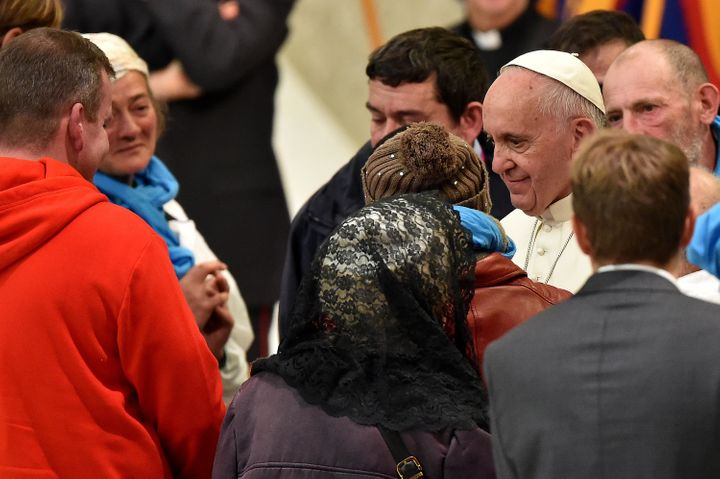 Pope Francis prays with homeless people on November 11, 2016 at the Vatican.