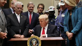 U.S. President Donald Trump signs H.J. Resolution 38, which nullfies the Òstream protection ruleÓ, The rule addresses the impacts of surface coal mining operations on surface water, groundwater, and the productivity of mining operations sites, at the White House in Washington, U.S., February 16, 2017. REUTERS/Carlos Barria
