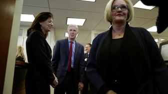 U.S. Supreme Court nominee Judge Neil Gorsuch (C) arrives for a meeting with Senator Claire McCaskill (D-MO) (R) on Capitol Hill in Washington, U.S., February 8, 2017. REUTERS/Yuri Gripas