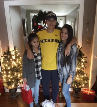 TheHerrera sisters with their brother,Arthur.
