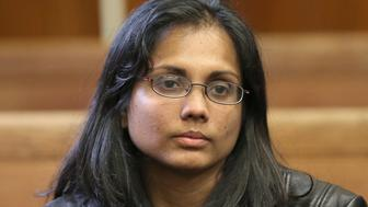 BOSTON - NOVEMBER 22: Dookhan, prior to entering a guilty plea. Annie Dookhan, former state chemist who mishandled drug evidence, entered a guilty plea during her court hearing at Suffolk Superior Court. (Photo by David L Ryan/The Boston Globe via Getty Images)