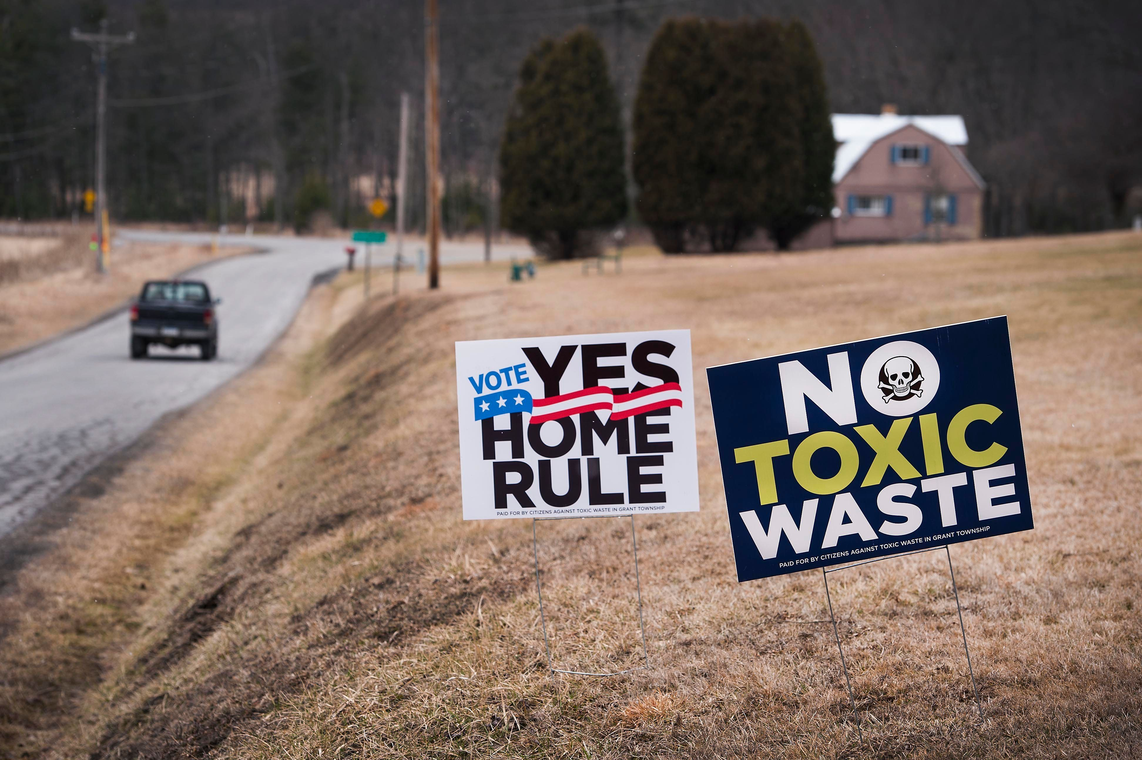 "Signs in Grant Township, Pennsylvania, oppose a fracking wastewater injection well and advocate for ""home rule,"" which g"