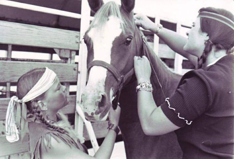 Overriding her death, there was a more humane and more living spirit to Lori Heimer. Photo of Lori, right, tending to a horse