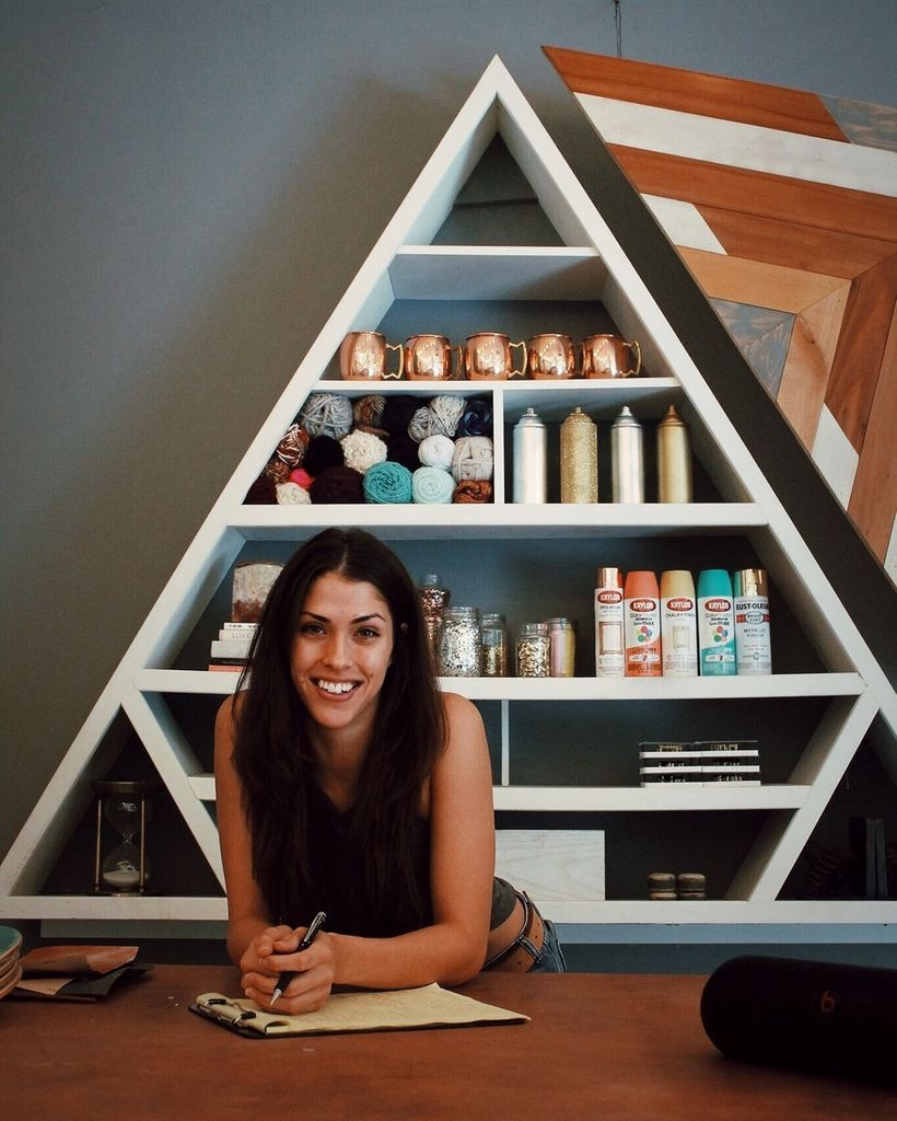 Rachel Metz pictured with her hand-crafted copper workshop table and triangular shelf, centre pieces for many of her videos.