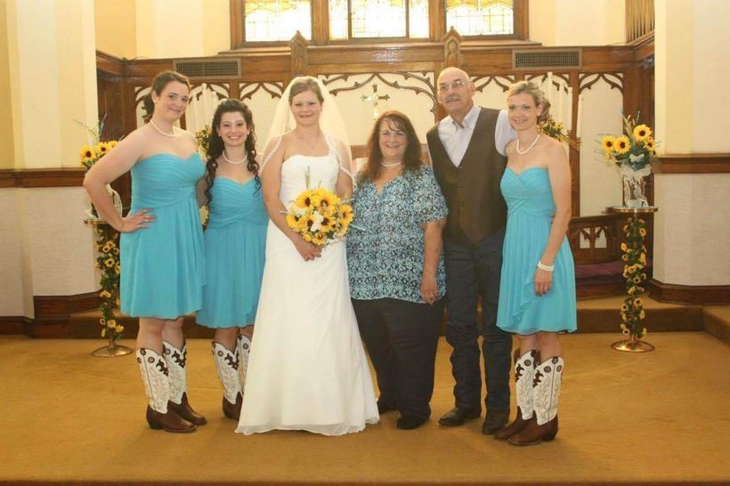 Lori, her husband Ron, and their four daughters at the wedding of their youngest daughter.  Lori's death is being investigate