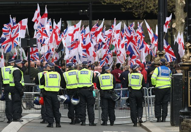 Police officers in front of Britain First and EDL protestors on