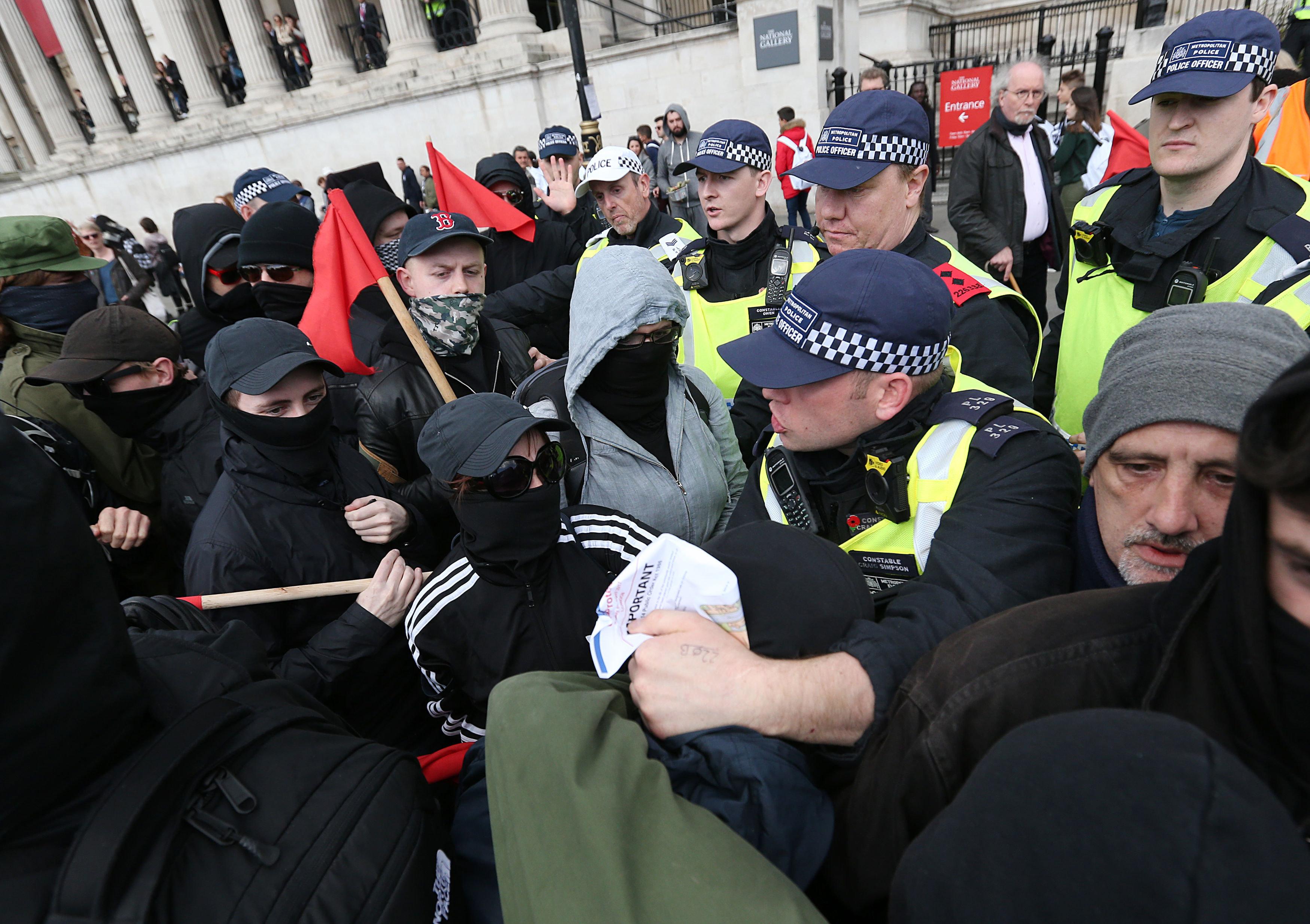UAF (Unite Against Fascism) demonstrators tussle with police officers in Trafalgar