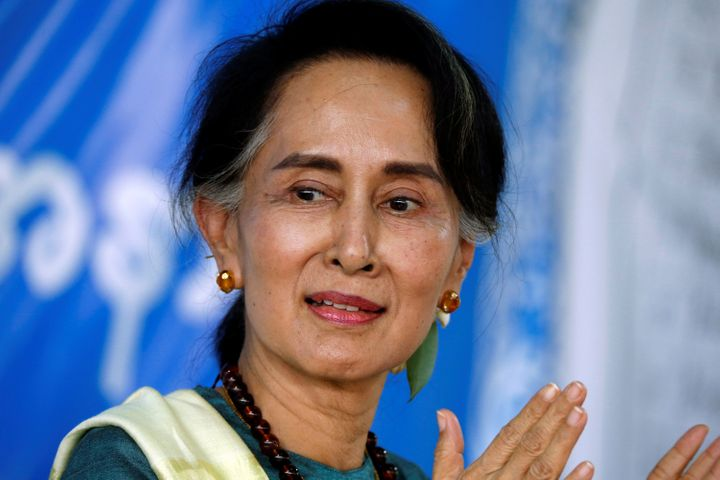 Myanmar State Counselor Aung San Suu Kyi smiles as she visits an IDP camp outside of Myitkyina, the capital city of Kachin st