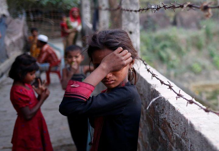 A Rohingya refugee girl wipes her eyes as she cries at Leda Unregistered Refugee Camp in Teknaf, Bangladesh, February 15, 201