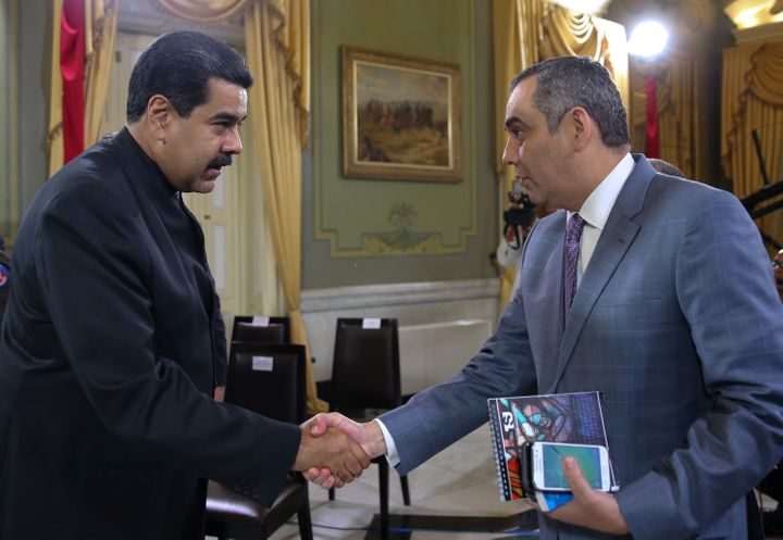 President Nicolas Maduro (L) and Supreme Court President Maikel Moreno shake hands during a meeting at Miraflores Palace in C