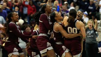 DALLAS, TX - MARCH 31:  Morgan William #2 of the Mississippi State Lady Bulldogs celebrates with teammates after making the game-winning shot to defeat the Connecticut Huskies 66-64 in overtime during the semifinal round of the 2017 NCAA Women's Final Four at American Airlines Center on March 31, 2017 in Dallas, Texas.  (Photo by Ron Jenkins/Getty Images)