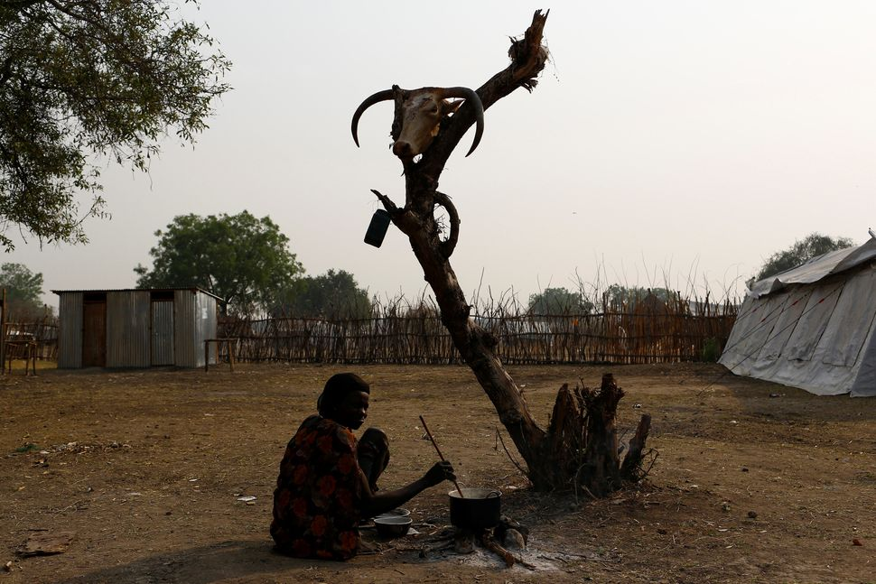 A woman cooks a meal in Pibor, a town in Boma state in South Sudan on Feb. 2.