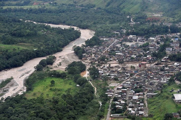 An aerial view shows a flooded area after heavy rains caused several rivers to overflow, pushing sediment and rocks into buil