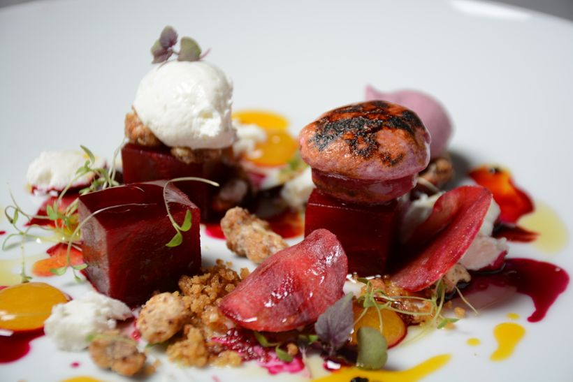 Beetroot with Red Beet Tartare, Beet Mellow and Beet Macaron with whipped goat cheese, and passion fruit.