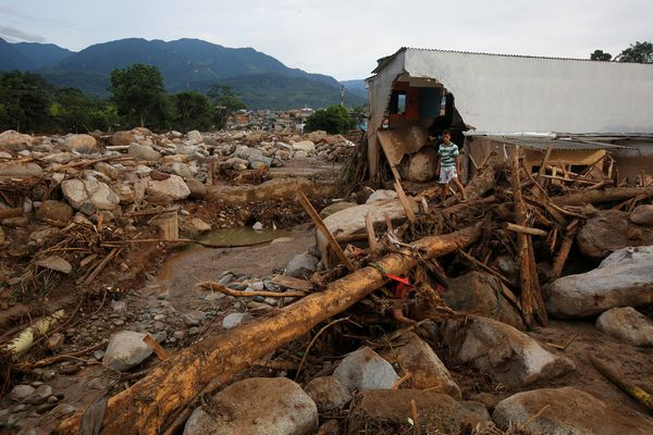 A man walks among the ruins in Mocoa on April 2.