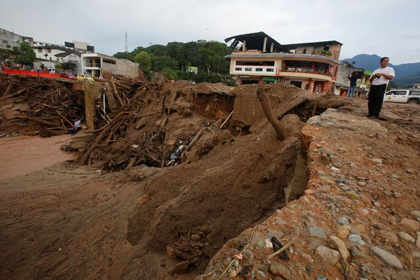 A man looks at a destroyed street in Mocoa on April 2.
