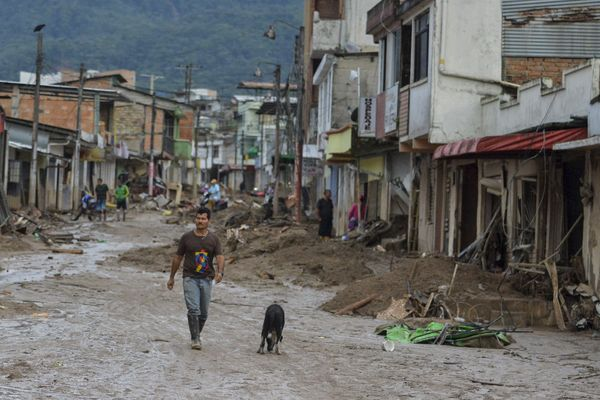 A man walks in a muddy street in Mocoa on April 2.