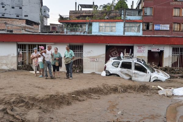 People look at the damage caused by mudslides in Mocoa on April 1.