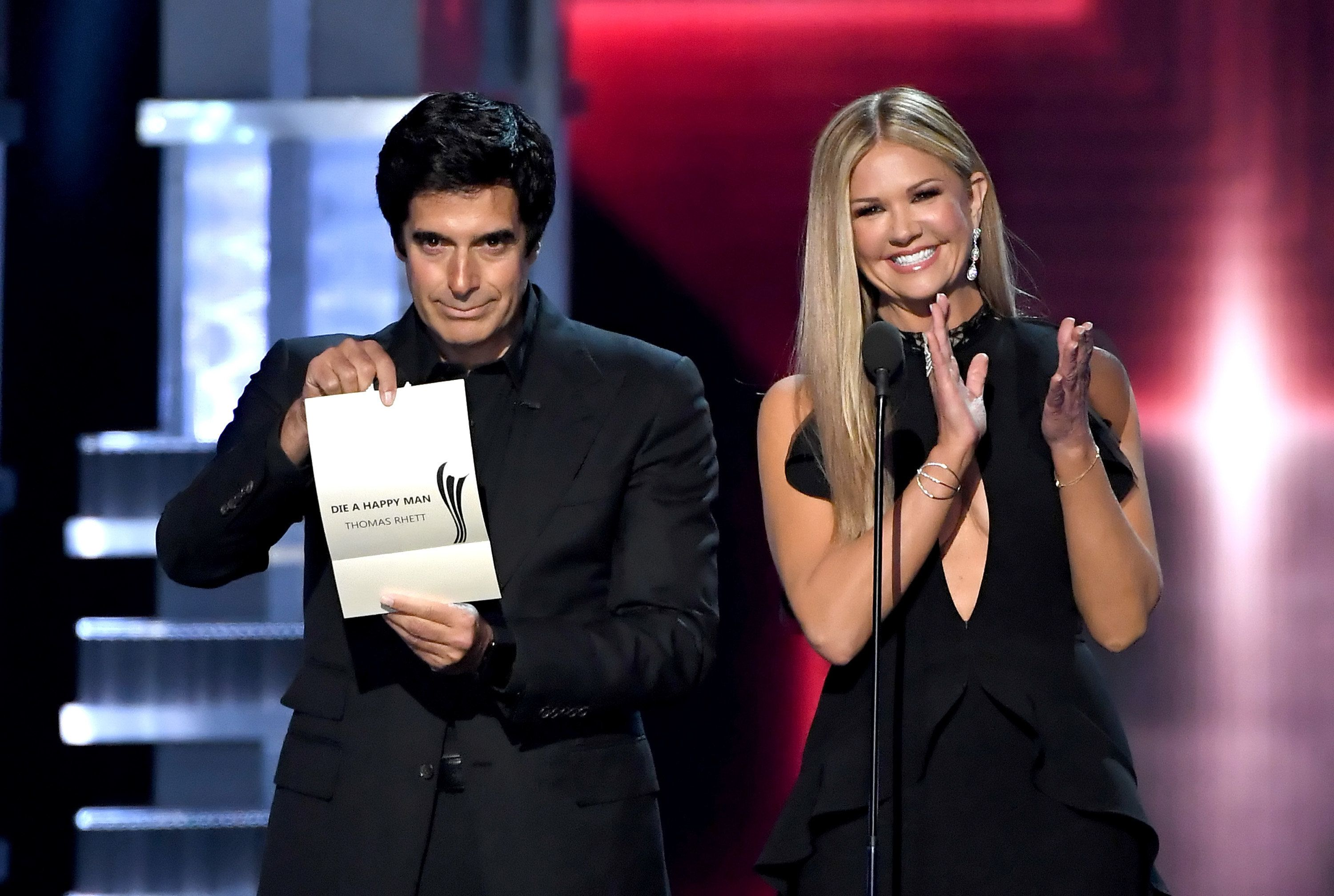LAS VEGAS, NV - APRIL 02:  Illusionist David Copperfield (L) and TV personality Nancy O'Dell speak onstage during the 52nd Academy Of Country Music Awards at T-Mobile Arena on April 2, 2017 in Las Vegas, Nevada.  (Photo by Ethan Miller/Getty Images)