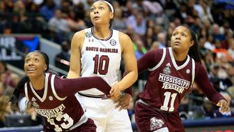 DALLAS, TX - APRIL 02: Allisha Gray #10 of the South Carolina Gamecocks is boxed out by Ketara Chapel #13 and Roshunda Johnson #11 of the Mississippi State Lady Bulldogs during the championship game of the 2017 NCAA Women's Final Four at American Airlines Center on April 2, 2017 in Dallas, Texas.  (Photo by Ron Jenkins/Getty Images)