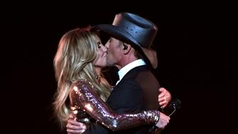 LAS VEGAS, NV - APRIL 02:  Recording artists Faith Hill (L) and Tim McGraw perform onstage during the 52nd Academy Of Country Music Awards at T-Mobile Arena on April 2, 2017 in Las Vegas, Nevada.  (Photo by Ethan Miller/Getty Images)