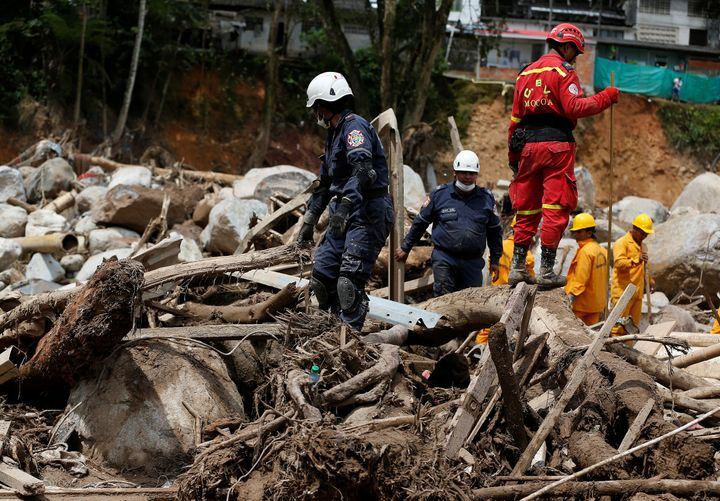 First responders look for the missing after flooding and mudslides hit Mocoa, Colombia.