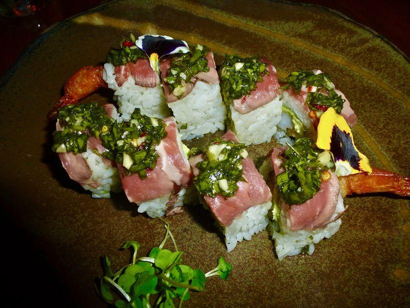 The Wagyu Beef Roll with crispy shrimp tempura, avocado, shibazuke and chimichurri soy.