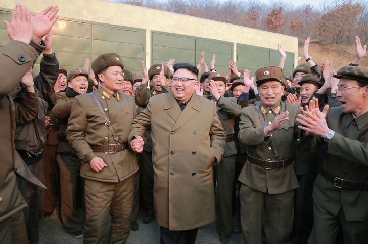 This undated pictureshowsNorth Korean leader Kim Jong-Un (centre)inspecting the ground jet test of newly developed high-thrust engine at a satellite facility