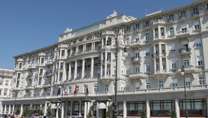 The grand sea-front facade of the Savoia Excelsior Palace, Trieste