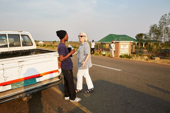 At the end of a long day, Margriet talks to Green Malata student Thomas, just before heading home. Blantyre, Malawi, 2016.