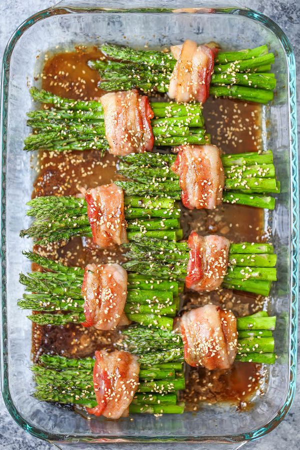 "<strong>Get the <a href=""http://damndelicious.net/2016/05/21/bacon-wrapped-asparagus/"" target=""_blank"">Bacon-Wrapped Asparagu"