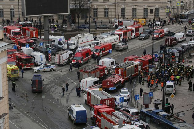 Dozens of emergency services vehicles gather outside the Russian train