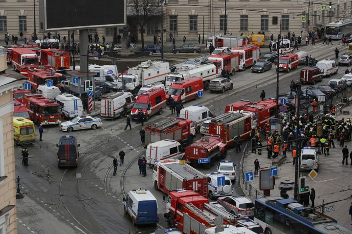 Dozens of emergency services vehicles gather outside the Russian train station