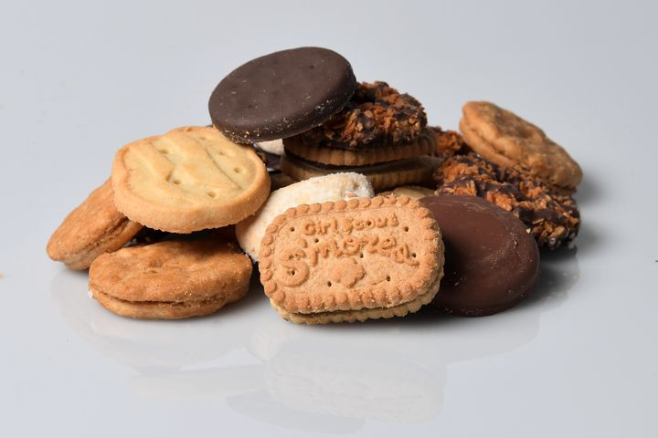 A cookie pile made up of beloved Girl Scout cookies.