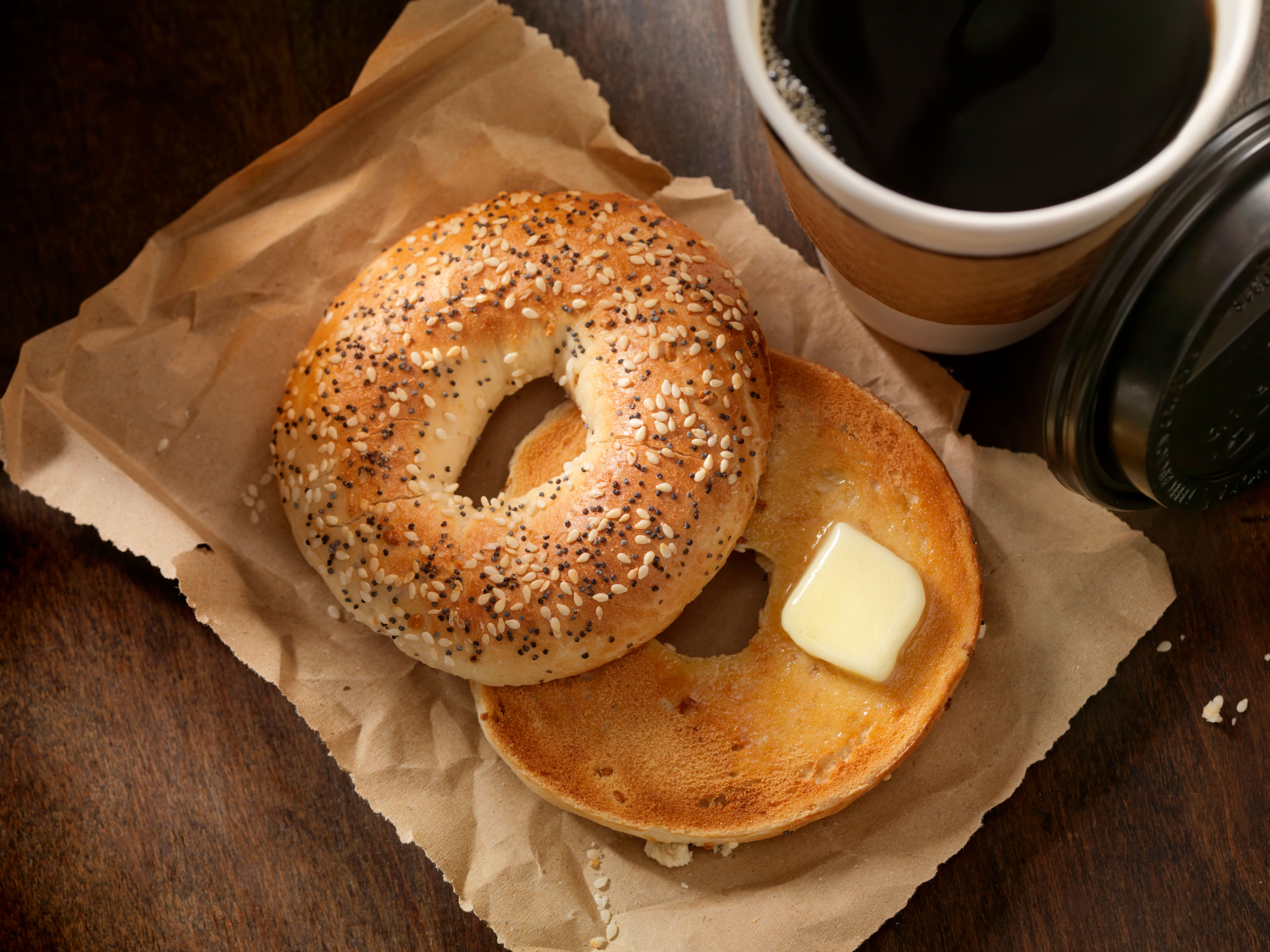 Toasted Bagel with Butter and a Take out Coffee - Photographed on a Hasselblad H3D11-39 megapixel Camera System