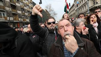 Hungarian antigovernment demonstrators whistle and clash with Orban supporters during the speech of Hungarian Prime Minister Viktor Orban at the National Museum in Budapest on March 15, 2017. Hungary celebrates the anniversary of the Hungarian Revolution, the 1848/1849 revolution in the Kingdom of Hungary grew into a war for independence from the Austrian Empire, ruled by the Habsburg dynasty. / AFP PHOTO / FERENC ISZA        (Photo credit should read FERENC ISZA/AFP/Getty Images)
