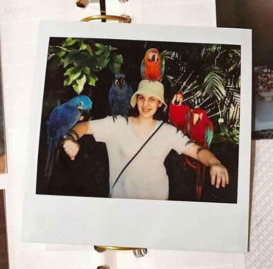 """""""What a beautiful day don't you wish you were holding some parrots while wearing a bucket hat?"""" she wrote on Insta."""