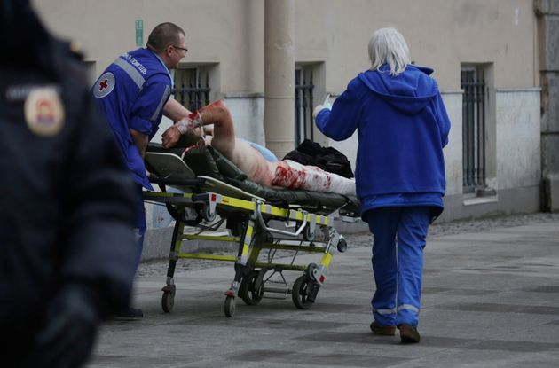 An injured person is helped by emergency services outside Sennaya Ploshchad metro