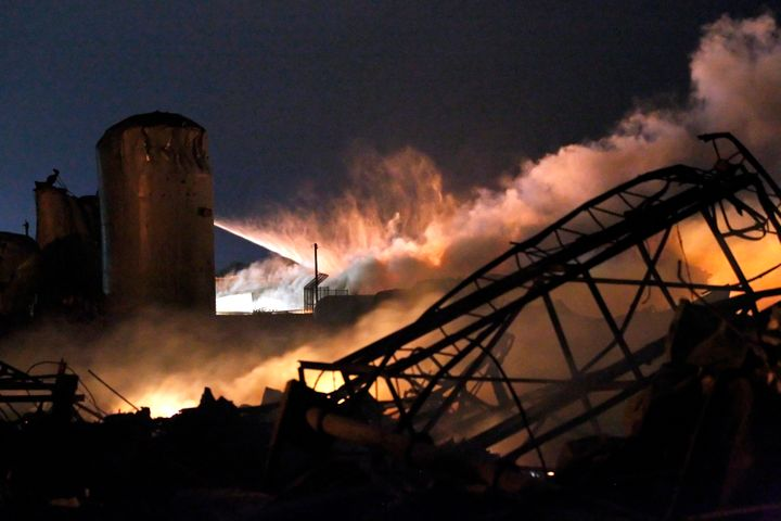 Smoke rises as water is sprayed at the burning remains of a fertilizer plant after an explosion at the plant in the town of W