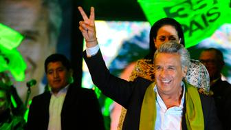 The Ecuadorean presidential candidate of the ruling Alianza PAIS party, Lenin Moreno, gives the 'V for victory' sign to his supporters as they wait for the final results of the runoff election, in Quito on April 2, 2017. / AFP PHOTO / JUAN RUIZ        (Photo credit should read JUAN RUIZ/AFP/Getty Images)