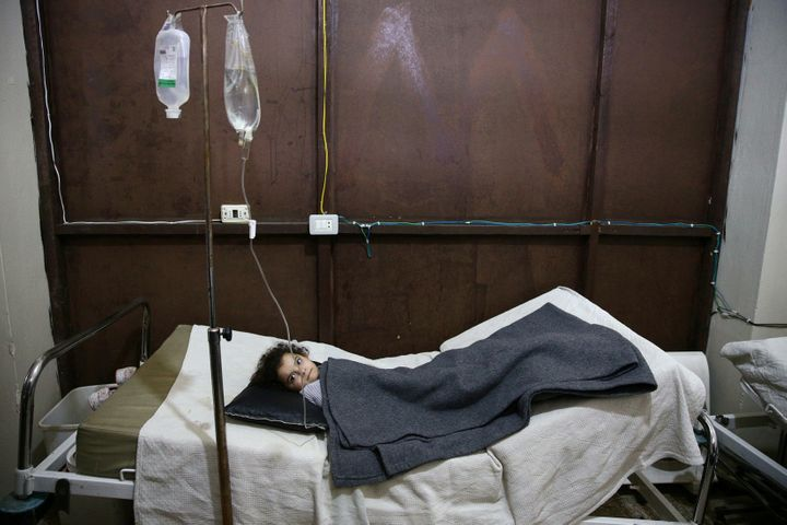 A girl rests in a field hospital in Harasta, after an airstrike hit a kindergarten in November 2016.