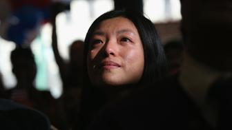 NEW YORK, NY - APRIL 09:  Chinese immigrant and new American citizen Yi Shu sheds a tear after taking the oath of citizenship at a naturalization ceremony on April 9, 2013 in New York City. Shu, who works at a hedge fund in New York City, was one of 15 immigrants from 13 countries who became U.S. citizens during the ceremony held at the Lower East Side Tenement Museum, which is dedicated to immigration history. Last year U.S. Citizenship and Immigration Services (USCIS), naturalized more than 676,000 new U.S. citizens and more than 84,000 of those were in the New York  district.  (Photo by John Moore/Getty Images)