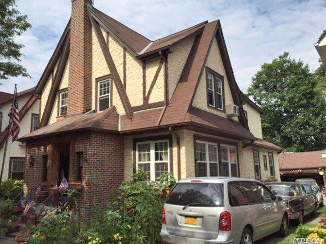 <p>The Tudor-style home has a brick-and-stucco façade.</p>