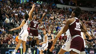 Mississippi State's Morgan William (2) puts up the game-winning shot at the buzzer in overtime against Connecticut in an NCAA Tournament semifinal at American Airlines Center in Dallas on Friday, March 31, 2017. Mississippi State won, 66-64, snapping UConn's 111-game winning streak. (Richard W. Rodriguez/Fort Worth Star-Telegram/TNS via Getty Images)