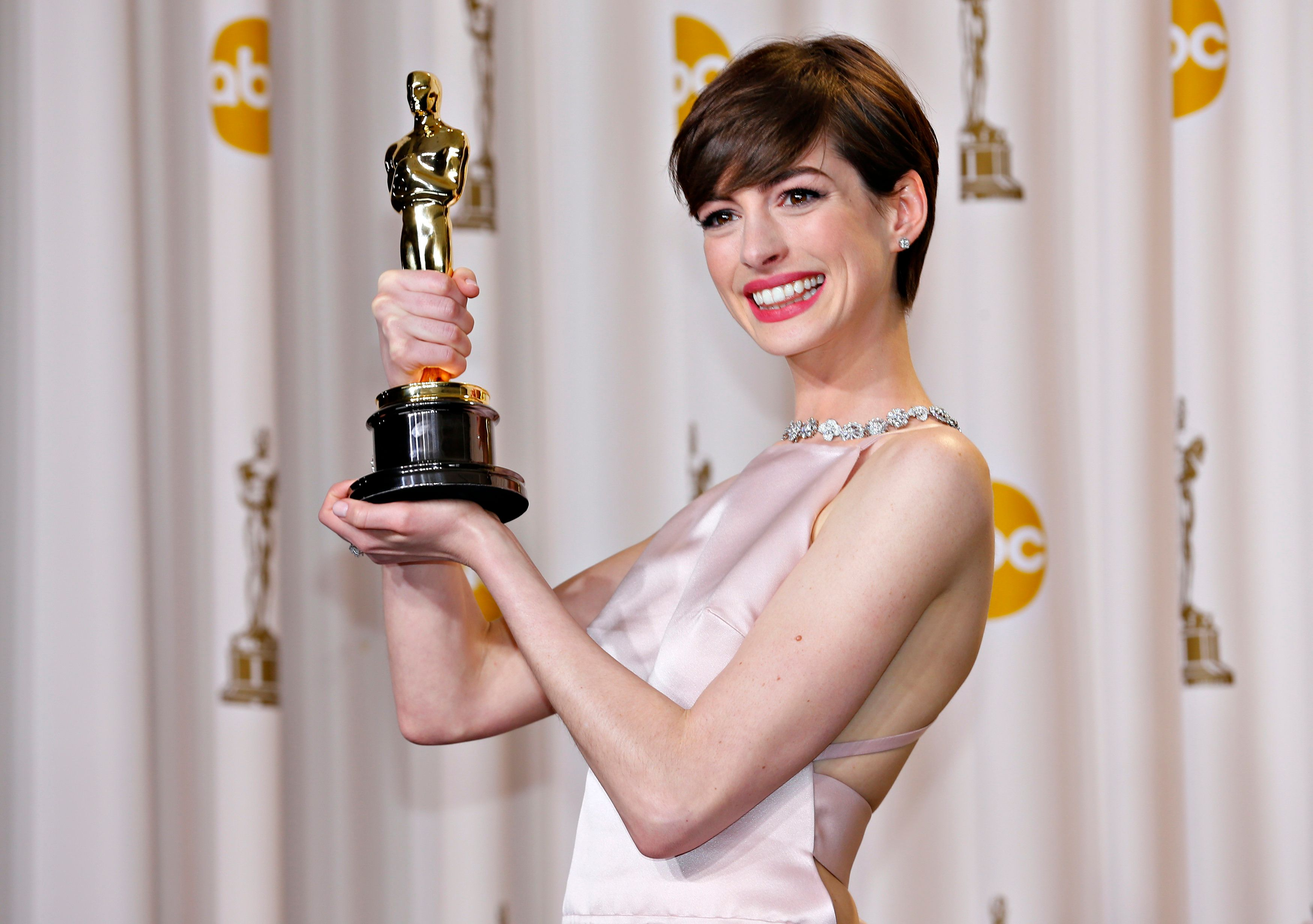 "Anne Hathaway holds her Oscar for winning Best Supporting Actress for her role in ""Les Miserables."""