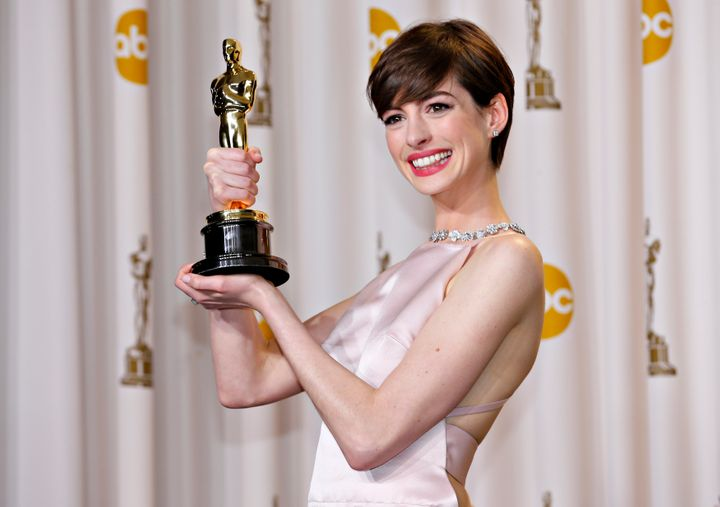 """Anne Hathaway holds her Oscar for winning Best Supporting Actress for her role in """"Les Miserables."""""""