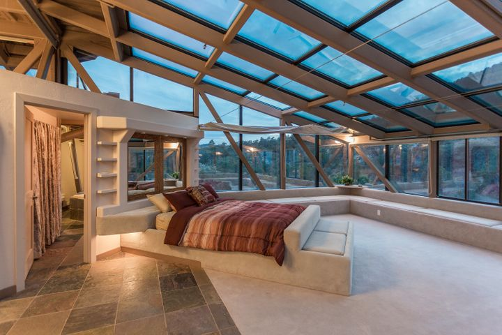 Bedrooms feature plenty of natural light thanks to glass ceilings.