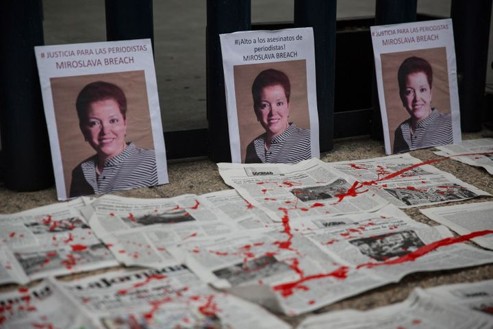 Portraits of slain journalist Miroslav Breach are displayed at a protest in Mexico City on March 25. She became the third Mex